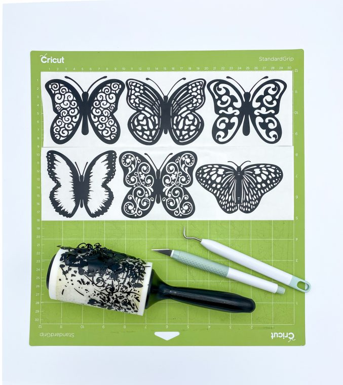 Weed the extra black vinyl to reveal the pattern of your butterfly.