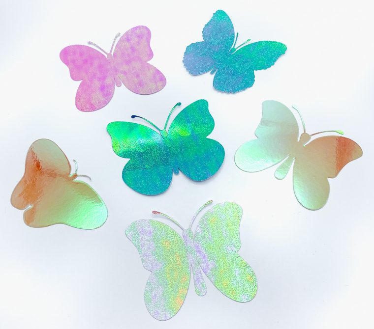 Butterfly SVG files cut from holographic paper.
