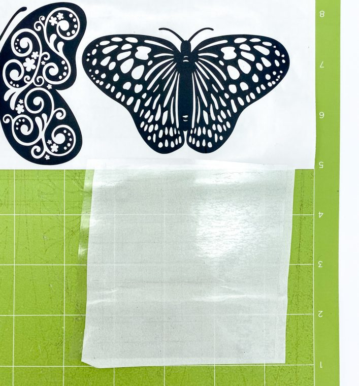 Cut a piece of transfer tape the size of your vinyl butterfly.