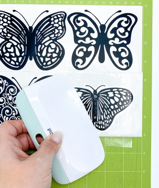 Attach transfer tape to the butterfly vinyl.