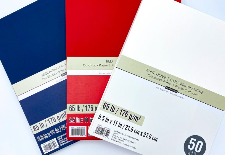 Red, white and blue paper for paper rocket craft.