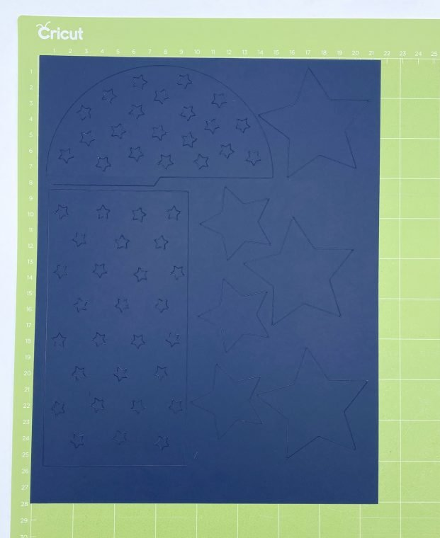 Paper rocket template cut from blue cardstock on Cricut machine.