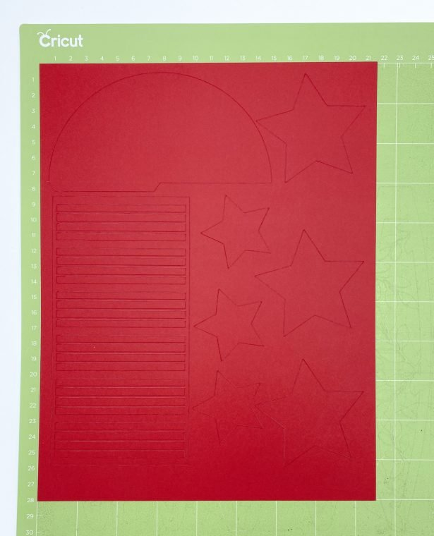 Paper rocket cut from red cardstock.