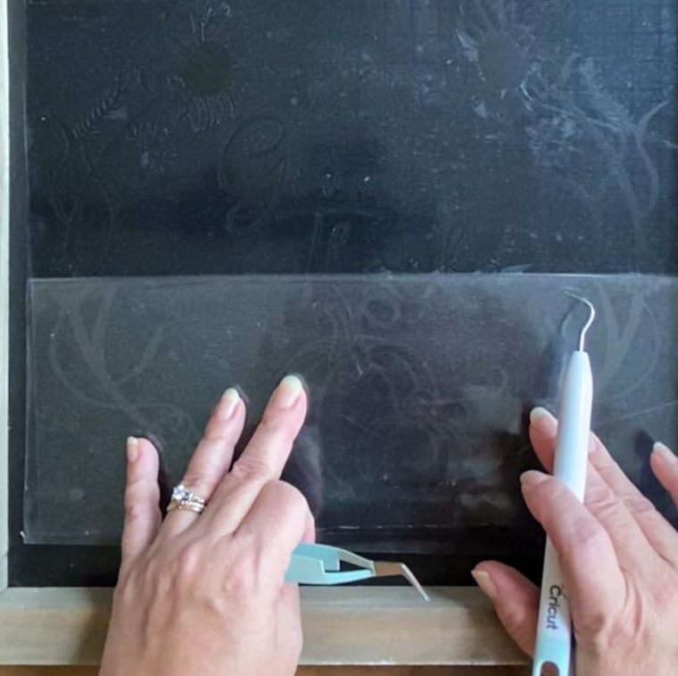 How to use transfer tape to place a vinyl stencil on a chalkboard